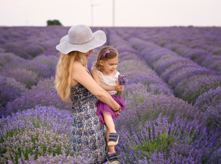 Lavender mood / Woman and girl enjoying a lavender field view
