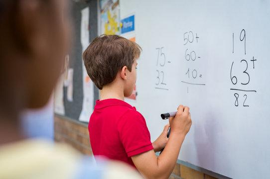 Boy solving math problem