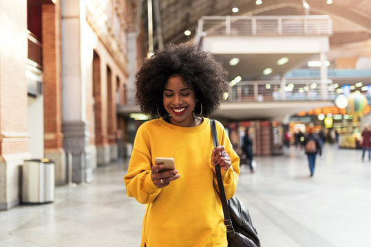 Beautiful woman using mobile in the train station