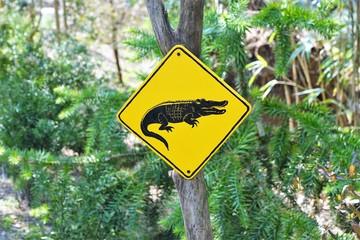 Door stickers Crocodile Australische Schilder mit Warnung in der Schweiz auf der Insel Brissago in der Nähe von Ascona