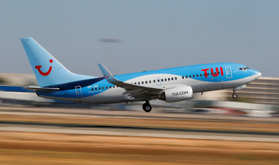 A TUI fly Belgium Boeing 737 airplane takes off from the airport in Palma de Mallorca