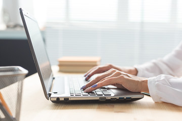 Technology, business and people concept- Woman's hand typing on keyboard