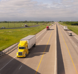 Yellow Semi Truck Trailer Rig Hauls Freight on Divided Highway