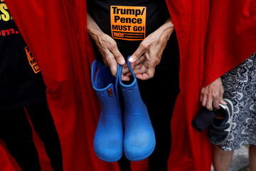 """Women dressed in red gowns as worn in the """"Handmaids Tale"""" protest U.S. Vice President Mike Pence and Department of Homeland Security (DHS) Secretary Kirstjen Nielsen outside the DHS Cybersecurity Summit in New York"""