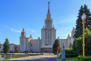 Main building of Lomonosov Moscow State University (MSU) on a blue sky background at summer evening