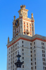 Tower with clock of Lomonosov Moscow State University (MSU) against blue sky in sunny summer evening
