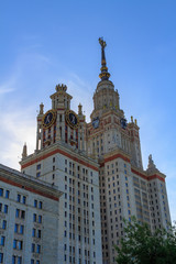 Lomonosov Moscow State University (MSU) in sunny summer evening on a blue sky background