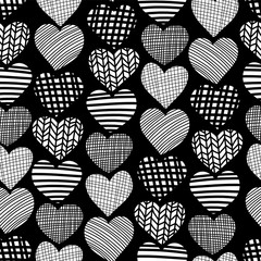 Doodle hearts seamless vector pattern. White hearts on black background. Textured hearts backdrop. Hand drawn shapes endless background. Graphic hand drawn illustration girls, Valentines day.