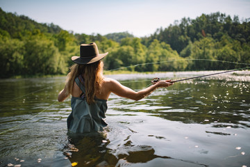 Allie Vannoy fly fishing in the Hiwassee River, TN
