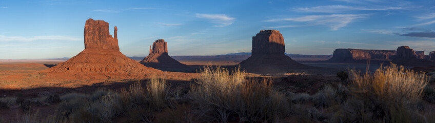 A panoramic image of the giant sandstone buttes at sunset in Monument Valley Navajo Tribal Park, Arizona, United States of America, North America