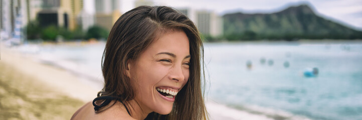 Happy Asian woman laughing smiling young adulthood lifestyle - Hawaii summer travel happiness banner panorama background.