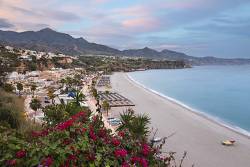 Sunset view over Nerja Playa Burriana beach, Nerja, Malaga Province, Costa del Sol, Andalucia, Spain, Europe