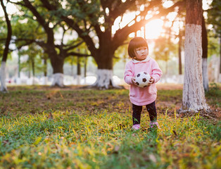 little girl with a football
