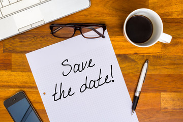 Save the date - written on white paper - office look