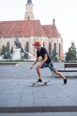 Man rolling with skateboard in the city square