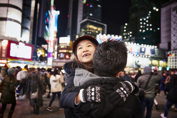 Girl with father in big city