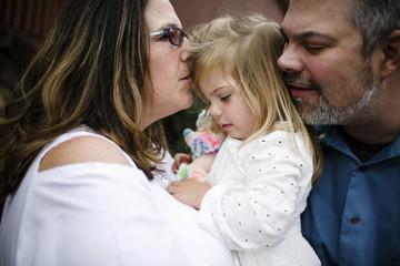Close-up of parents with daughter enjoying at tourist resort