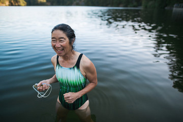 Portrait of smiling active woman after swimming in a lake