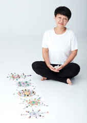 Mandala pattern with crystal and Asian women. a creator