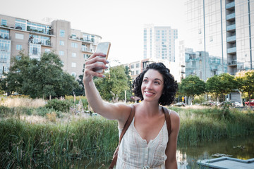 Beautiful Woman Taking Selfie Picture with Her Phone