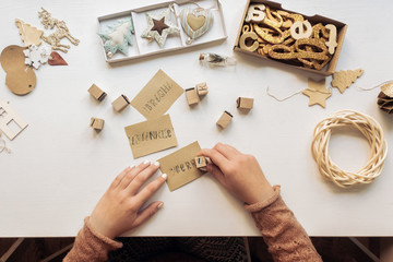 Woman Making Christmas Cards With Stamps