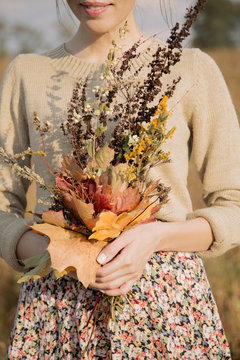 Crop woman with bunch