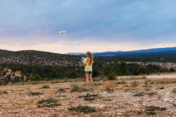 Woman flying drone at mountains