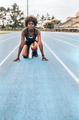 Black athlete woman on a race track