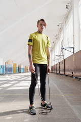 Athletic young man in sports hall