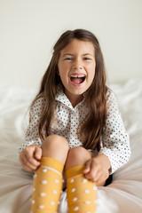Happy girl wearing polka dots