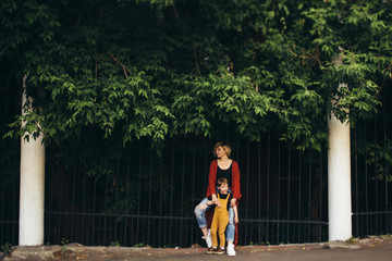 Woman and little son at the fence