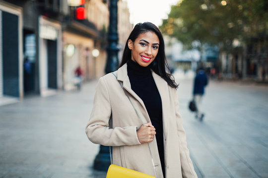 Portrait of a smiling stylish woman in the street.