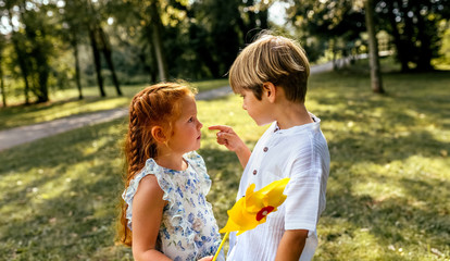 Portrait of a little brother and sister in the park