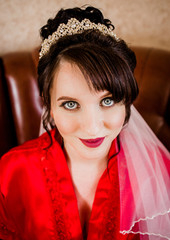 Cute bride in red dressing gown