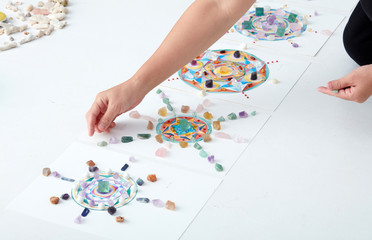 Mandala pattern, watercolor painting. with crystal and hand