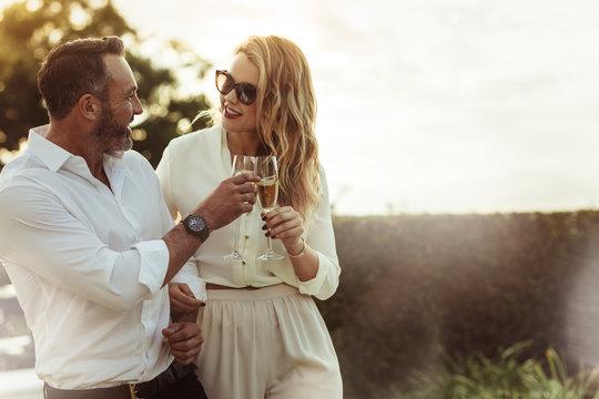 Romantic couple toasting wine