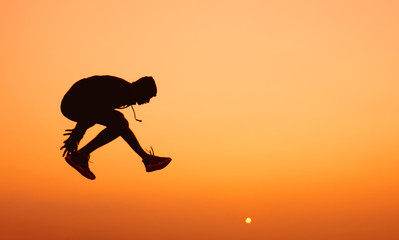 young man jumping.