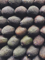 Pile of organic avocados at farmer's market
