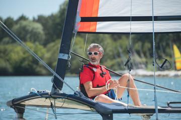 man on a sailboat