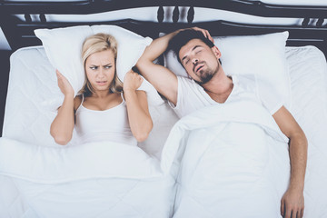 Top View of Man Snoring Loudly Wife Blocks Ears