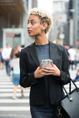 Businesswoman walking in the city
