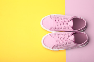 Wall Mural - Stylish new shoes on color background, top view