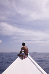 Young boat captain looking to the horizon