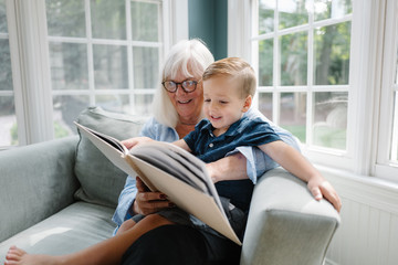 Grandmother reading with her grandson