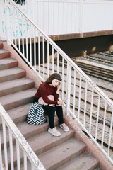 Woman on stairs looking at smartphone