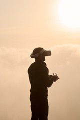 Man with VR headset in sunset
