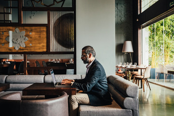 Businessman Working on Laptop at Restaurant
