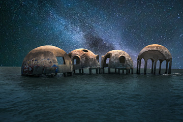 Milky way stars across a night sky over the Cape Romano dome house