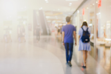 abstract blurred people walking or standing in street shopping center use us background