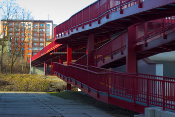 New red bridge over railway and block of flats
